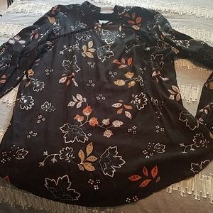 Black floral blouse with choker style neck and but